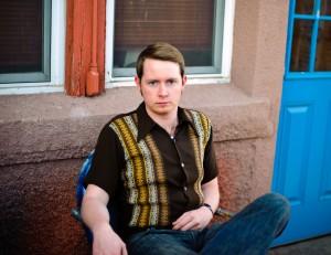 John outside the Blue Door
