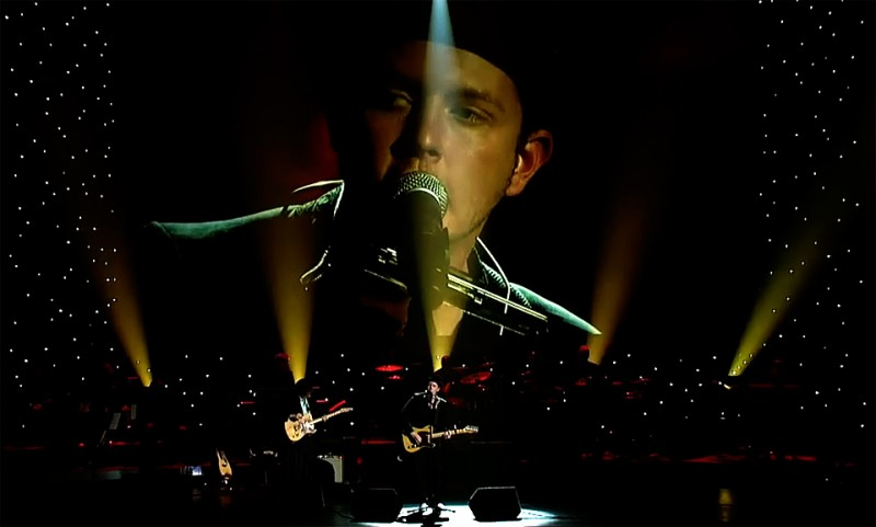 John onstage at the Grammys, 2013