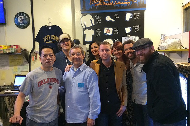 Rupert at Hello Deli with the band. Rupert is wearing an Oklahoma T-shirt